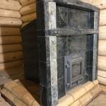 Банная печь Гефест в облицовке и с порталом из серпентинита